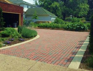 Brick driveway made from permeable pavers from Hanover Architectural Products. Completed 2009. Private residence, Goshen, IN.
